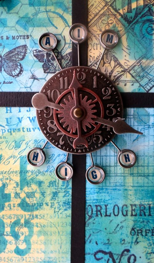 Closeup of paper kite center... Tim Holtz's Idea-ology embellishments on top of Distress Inks, Stamps, and Stencils (Marjie Kemper)